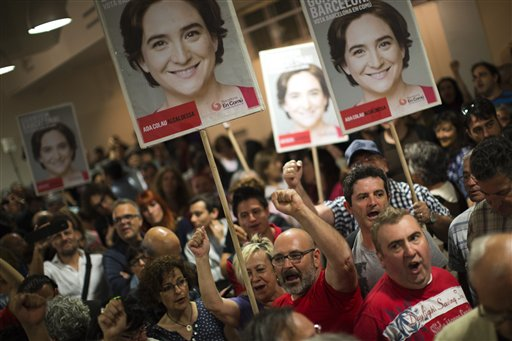 Supporters of the leader of leftist coalition Barcelona Together, Ada Colau, celebrate the victory of their party after elections in Barcelona, Spain, Sunday, May 24, 2015. New parties won strong support in Spain's local elections Sunday as voters turned their back on the country's traditional political heavyweights, an exit poll indicated. There was also an upset in Barcelona, where a popular anti-eviction campaigner backed by We Can was poised to unseat the region's long dominant and conservative Convergence and Union party. (AP Photo/Emilio Morenatti)