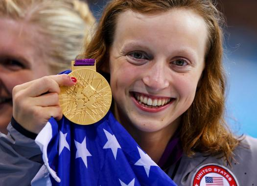 Katie Ledecky of the U.S. poses with her gold medal after winning the women's 800m freestyle final during the London 2012 Olympic Games at the Aquatics Centre August 3, 2012. REUTERS/Michael Dalder (BRITAIN - Tags: SPORT SWIMMING TPX IMAGES OF THE DAY OLYMPICS)