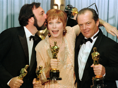 09 Apr 1984, Los Angeles, California, USA --- Los Angeles: Academy Award winners Jack Nicholson (R-Best Supporting Actor for ), Shirley Maclaine (C-Best Actress for ) and James Brooks (L-Best Picture, Best Director and Best Writing for ) greet the press holding their Oscars and extremely happy. --- Image by © Bettmann/CORBIS