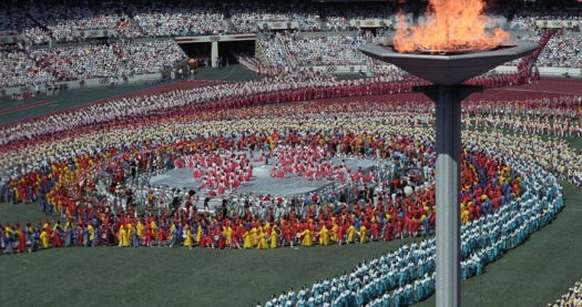 Athletes from a record 160 nations parade beneath the Sacred Flame during the opening ceremony of the 24th Olympic Games September 17, 1988 in Seoul. FOR EDITORIAL USE ONLY SCANNED FROM NEGATIVE REUTERS/IOPP/Santiago Lyon DEC/CMC - RTRUER3