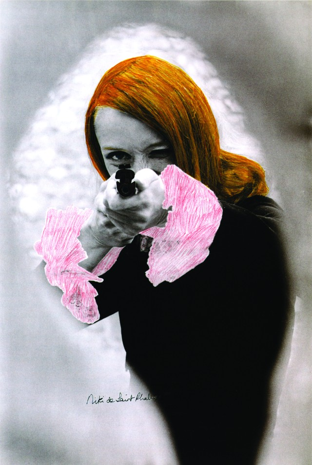 "Niki de Saint Phalle aiming; colored Film-Still of ""Daddy"", 1972"